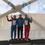 Победительница и призеры спринтерской гонки в дисциплине